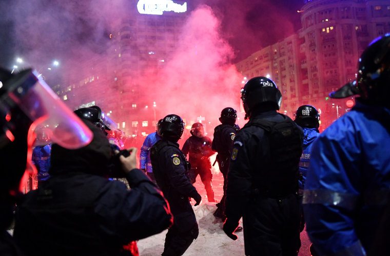 Image: Romanian riot police clash with protesters during a demonstration in front of the government headquarters in Bucharest, on Feb. 1.