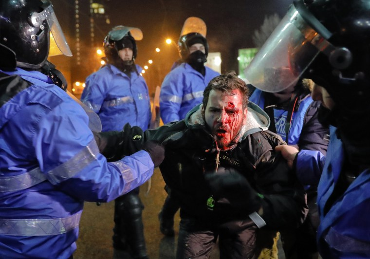 Image: Romanian riot police detain a man, face covered in blood, after minor clashes erupted during a protest in Bucharest, Romania, Feb. 2, 2017