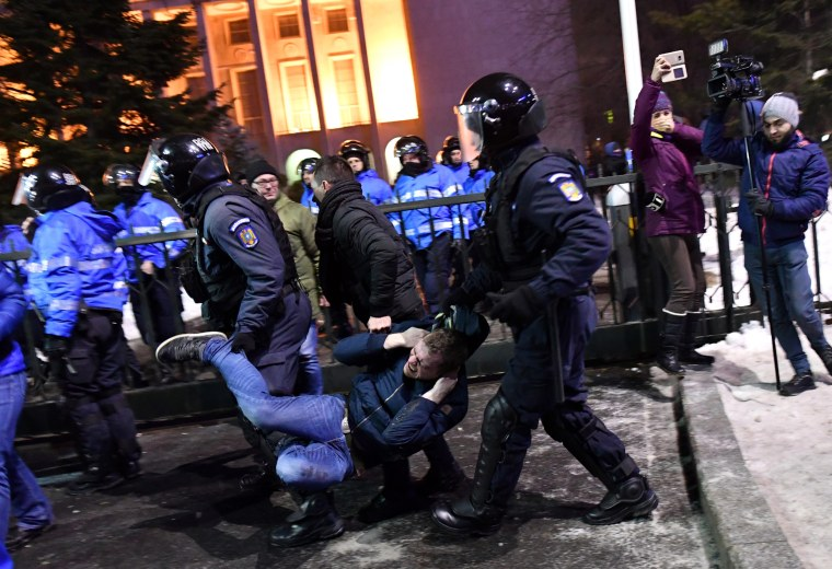 Image: Romanian riot police  evacuate a protester during a demonstration in front of the government headquarters in Bucharest, on Feb. 1.
