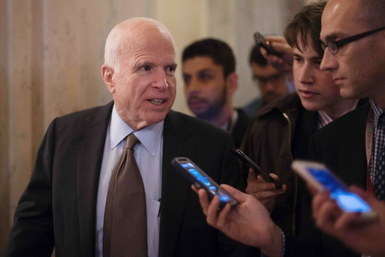 Image: McCain talks with reporters on Capitol Hill