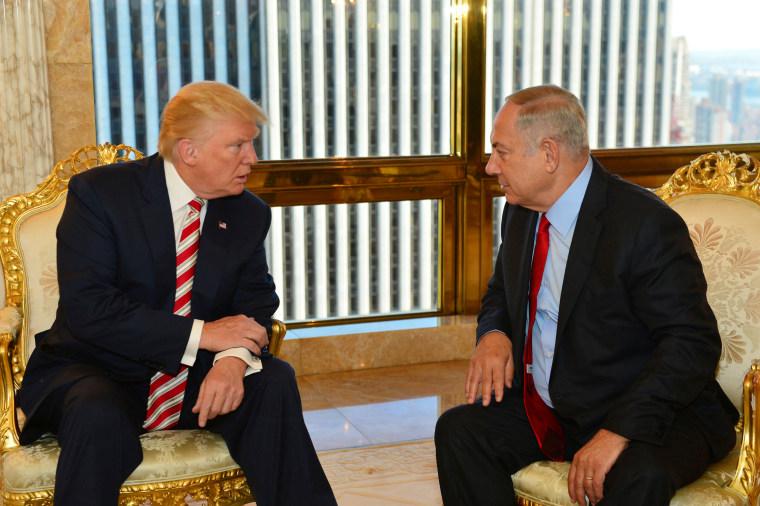 Image: Israeli Prime Minister Benjamin Netanyahu speaks to President Donald Trump during their meeting in New York on Sept. 25, 2016.