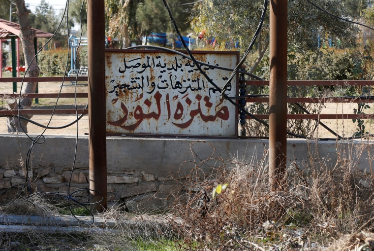 "Image: A sign reads ""Nour Park"" in Arabic at Mosul's zoo, Iraq"
