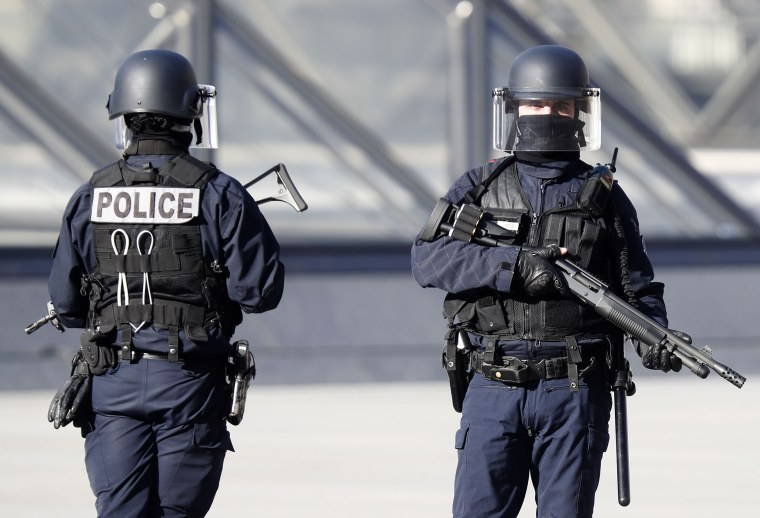 Image: Police officers stand guard near the Pyramid of Le Louvre Museum, close to the Carrousel du Louvre, where a French soldier opened fire after an attempted machete attack by a man allegedly shouting 'Allahu akbar', in Paris, France, Feb. 3, 2017.