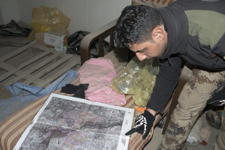 Image: Image: An Iraqi Counter Terrorism Service officer on patrol finds a map of Mosul in a destroyed hospital used as a base by Islamic State commanders when targeted for an airstrike by U.S. Coalition forces, Hay az Zara'a, eastern Mosul, Feb. 2, 2017.