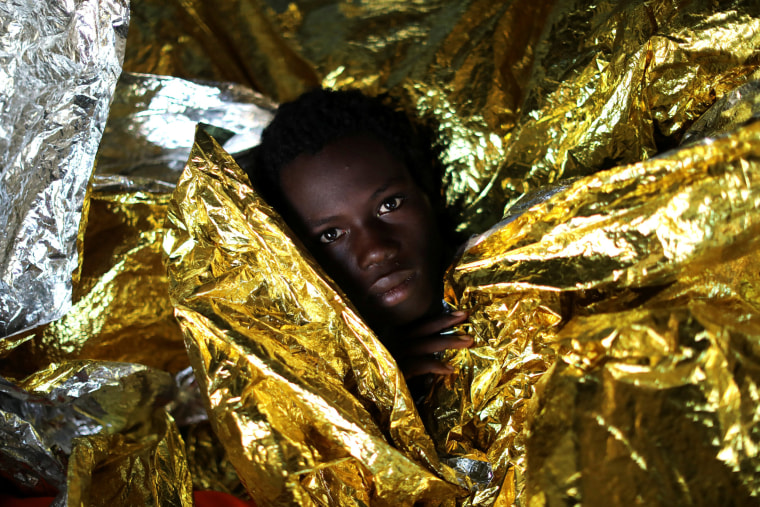 Image: Mamahba, 17, from Guinea, is covered with thermal blankets aboard the former fishing trawler Golfo Azzurro of the Spanish NGO Proactiva Open Arms following a rescue operation near the coasts of Libya in the central Mediterranean Sea on Feb. 3.