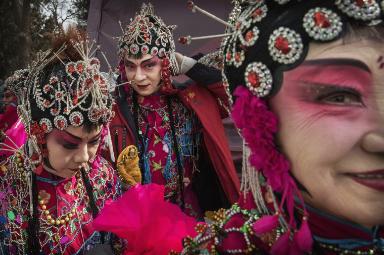 Image: Chinese dancers wear costumes after performing at a fair on the second day of the Chinese Lunar New Year on Jan. 29 in Beijing, China.