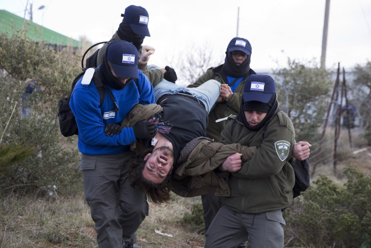 Image: Israeli police arrest a settler in Amona outpost in the West Bank, on Feb. 1.