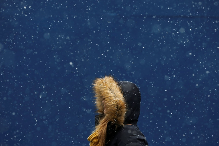 Image: A woman walks in the snow at Times Square in New York City on Jan. 31.