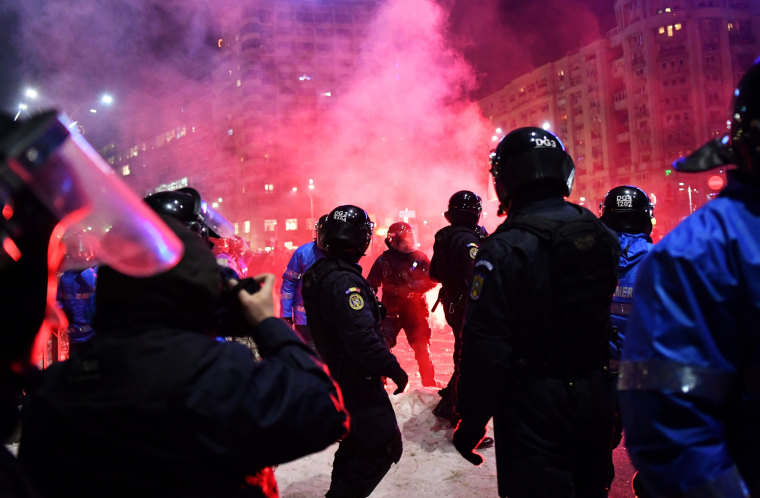 Image: Romanian riot police clash with protesters during a demonstration against controversial decrees to pardon corrupt politicians and decriminalize other offenses in front of the government headquarters in Bucharest on Feb. 1.
