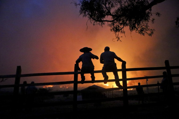 Image: Residents watch the forest burn in Portezuelo, Chile on Jan. 29, 2017.