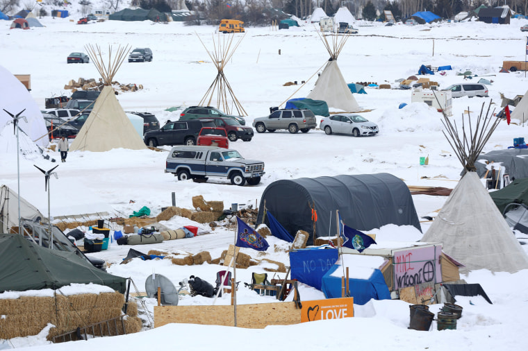 Image: Signs hang in the Dakota Access Pipeline protest camp on the edge of the Standing Rock Sioux Reservation near Cannon Ball, North Dakota on Jan. 24.