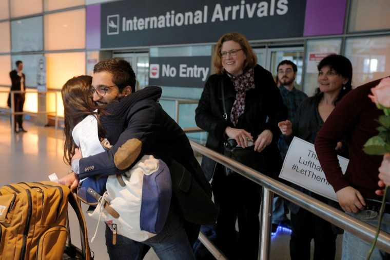 Image: Behnam Partopour, a Worcester Polytechnic Institute student from Iran, is greeted by his sister Bahar at Logan Airport after he cleared U.S. customs and immigration on an F1 student visa in Boston, Massachusetts, Feb. 3, 2017.