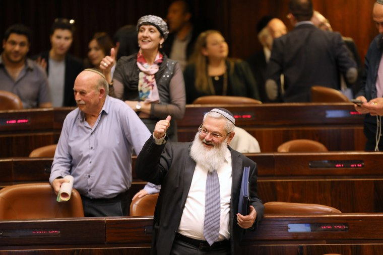 Image: Deputy Minister in the Ministry of Defense, Eli Ben-Dahan and other Israeli lawmakers gesture