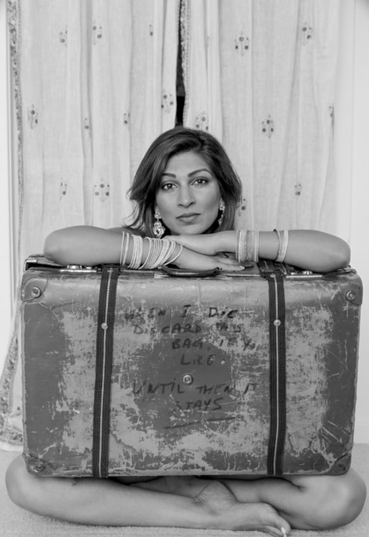 Playwright Minita Gandhi carries her father's old suitcase from the '70s.