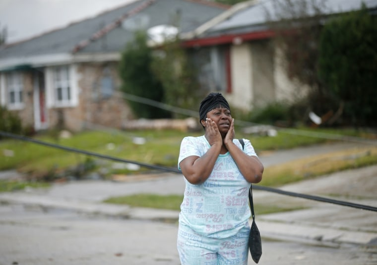 Image: Lisa Carruth reacts as she surveys the damage after a tornado tore through the eastern part of New Orleans, Feb. 7, 2017.
