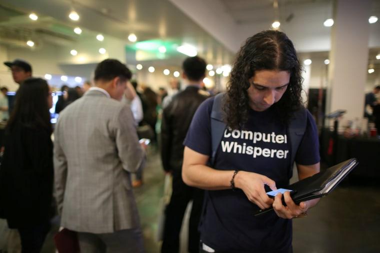 Image: Angello Pozo attends TechFair LA, a technology job fair in Los Angeles