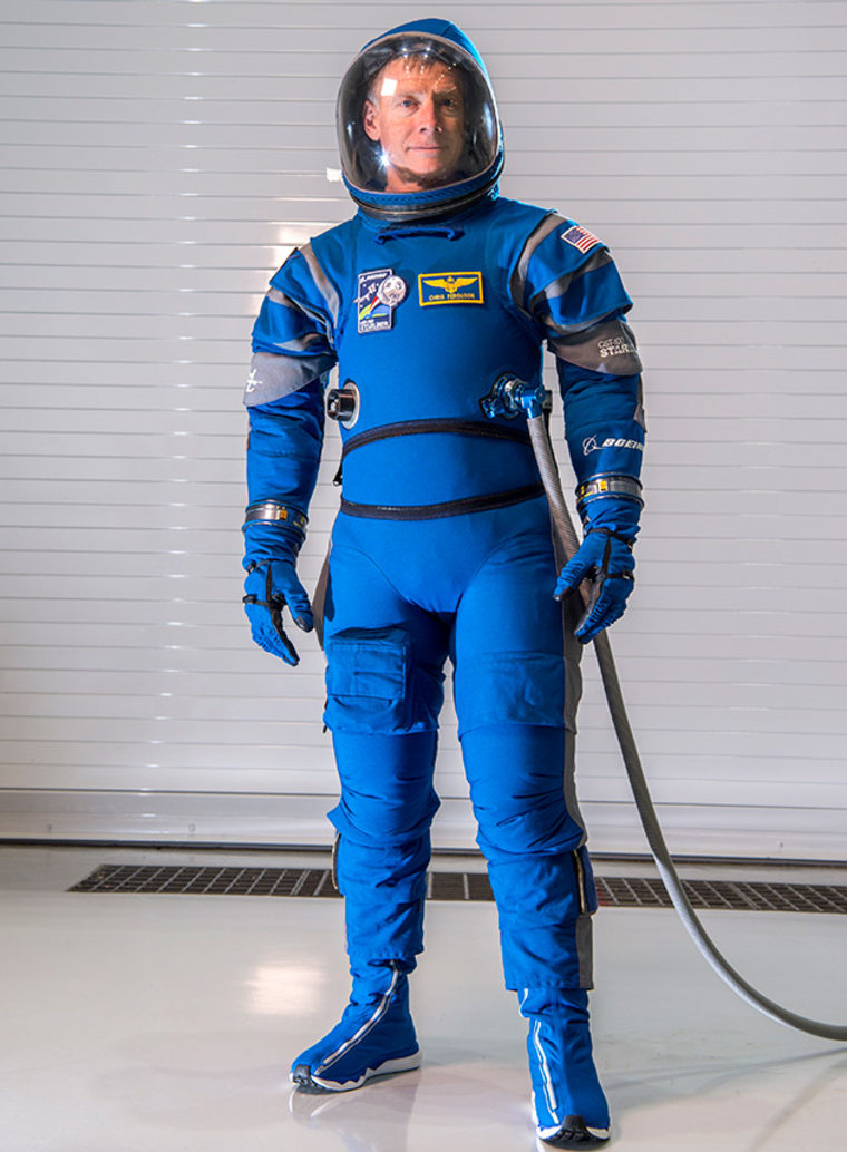Former NASA astroanut Chris Ferguson, Boeing's director of Starliner Crew and Mission Systems, models the new spacesuit that passengers will wear aboard Boeing's Starliner spacecraft. According to NASA, the design is lighter and more comfortable than the spacesuits earlier astronauts wore. 