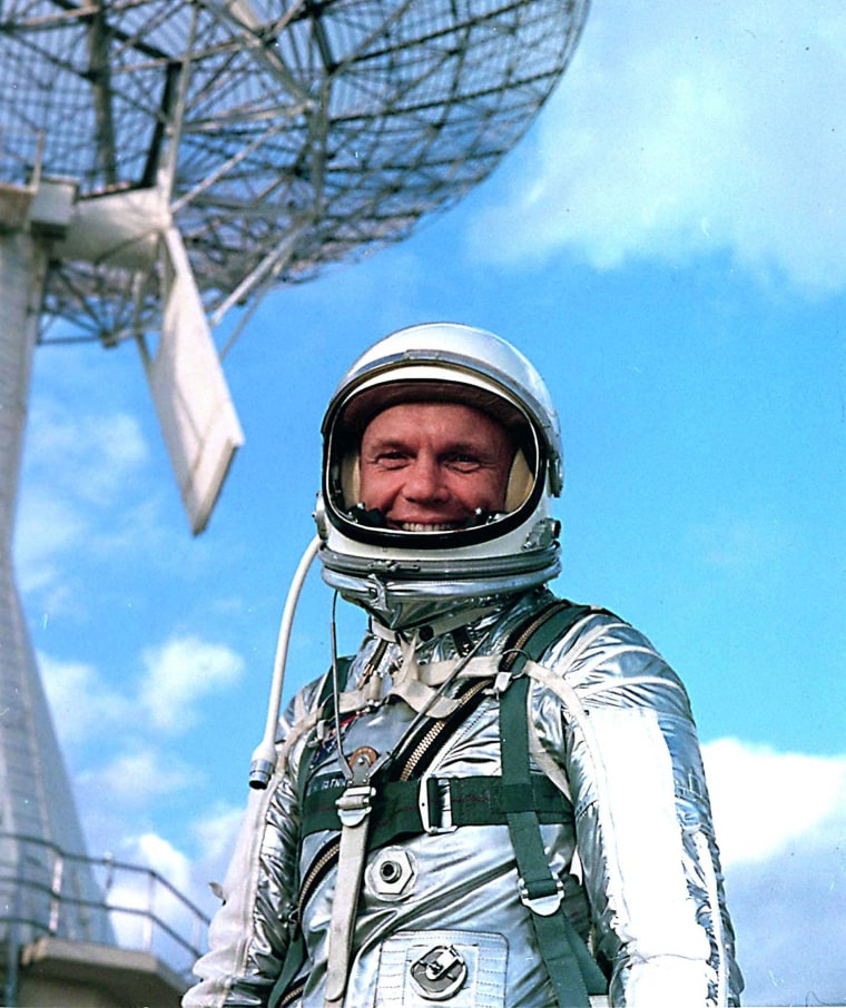 Astronaut John Glenn wears a training version of a Mercury spacesuit during a break from training for the Mercury-Atlas 6 mission in 1962, when Glenn became the first American to orbit the Earth.