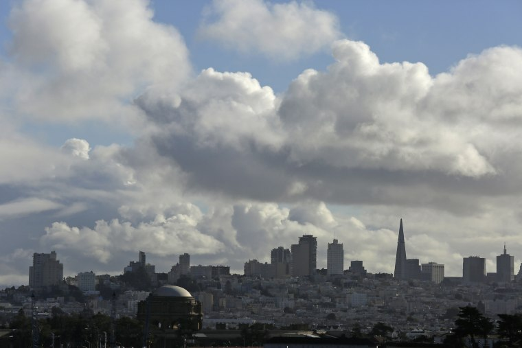 Image: Clouds hover over the skyline during a break in the weather in San Francisco.