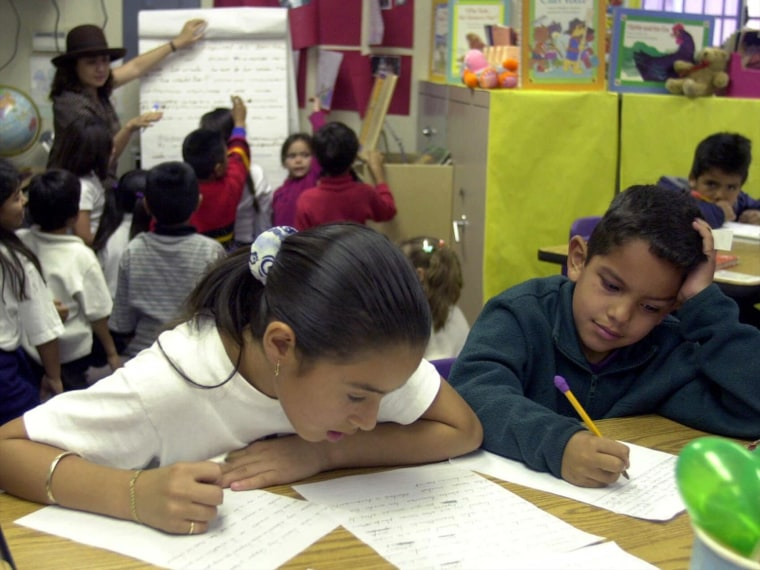 ELEMENTARY SCHOOL STUDENTS WRITE IN CLASSROOM