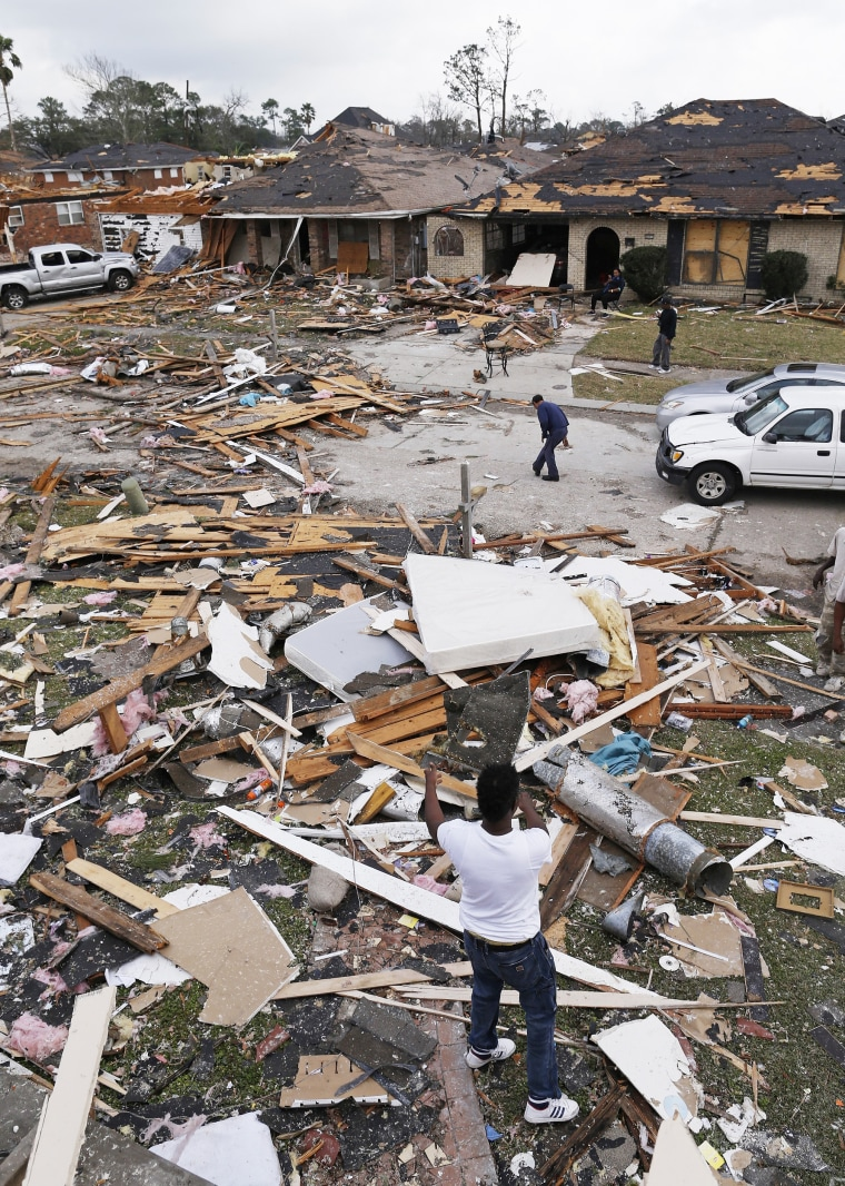 Image: Dwight Powell clears debris from his yard a day after a tornado touched down in eastern New Orleans on Feb. 8.