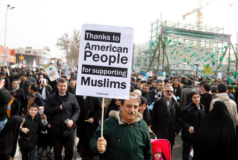 Image: Iranians mark the 38th anniversary of the 1979 Islamic revolution in Tehran, Friday.