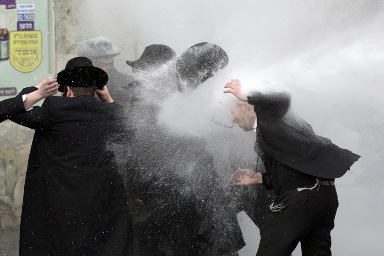 Image: Israeli police use water cannon to disperse Ultra-Orthodox Jewish demonstrators