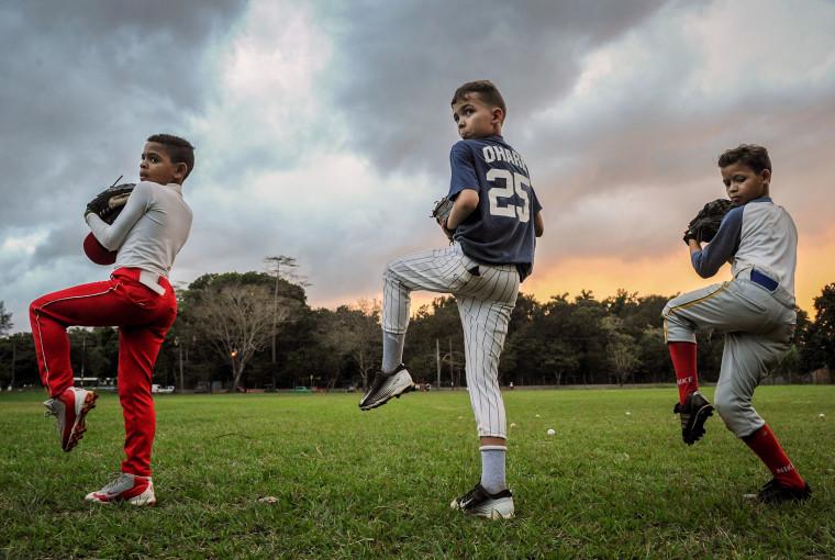 Image: Cuban children train during a baseball practice in Havana
