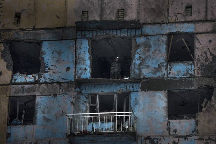 Image: A Ukrainian fighter of the Right Sector battalion stands in a building damaged by shelling in Avdiivka