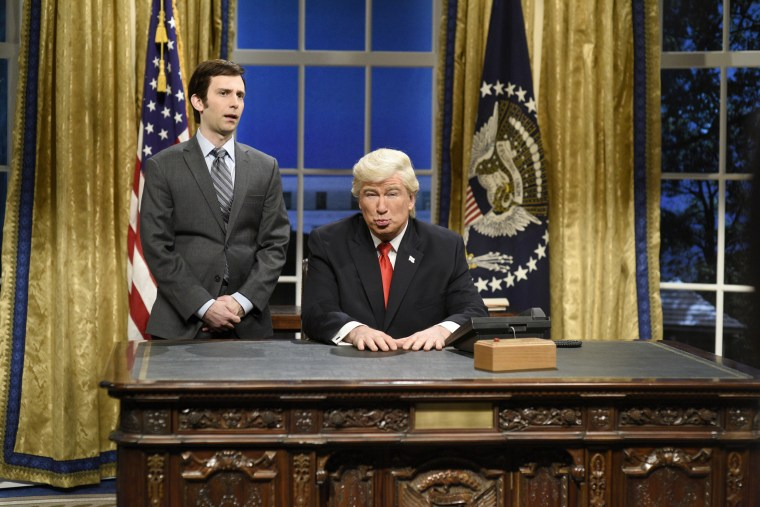 Image: Kyle Mooney plays a presidential aide and Alec Baldwin plays President Donald J. Trump during the Oval Office Cold Open for Saturday Night Live on Feb. 4, 2017.