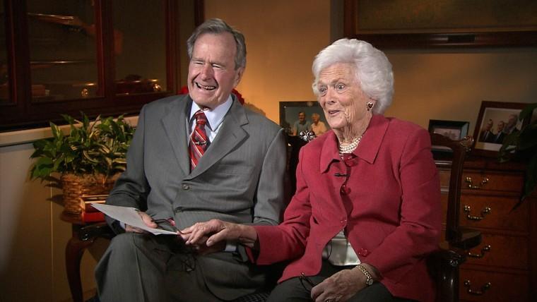 George H.W. Bush and Barbara Bush read letters