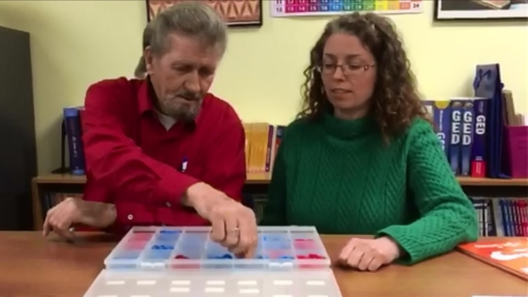 Osborne teaches Burns to build words using small plastic letters.