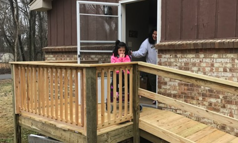 Verna DeSpain helps Lydia go outside and use the ramp for the first time