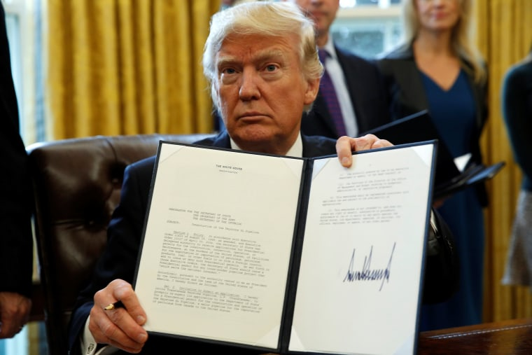 Image: President Trump signs executive orders at the White House in Washington
