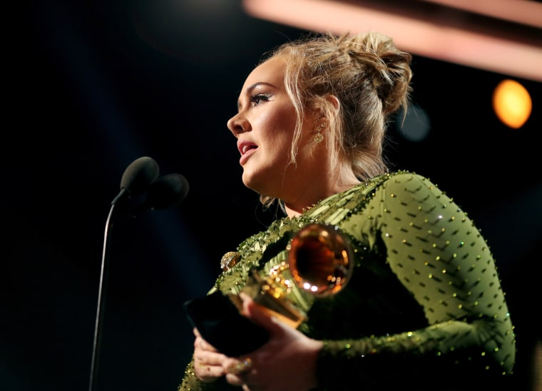 Image: Singer Adele accepts the award for song of the year