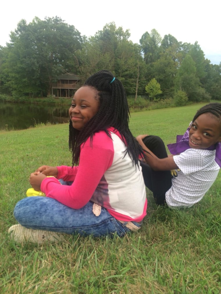 Takiya Holmes, 11, left, was killed in a shooting in February.