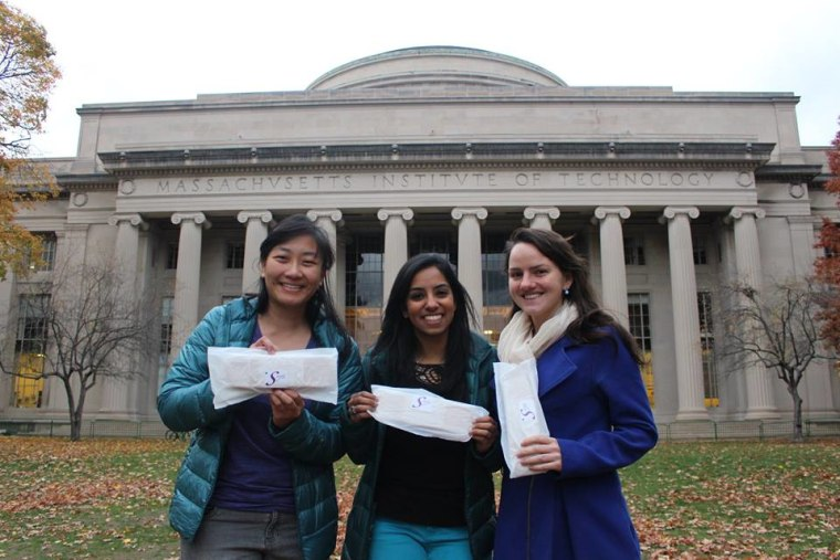 Kristin Kagetsu, Amrita Saigal, and Grace Kane (three of the four founders of Saathi Pads) pose in front of MIT.