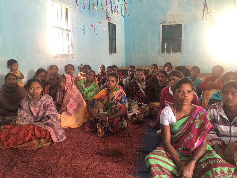 Women gather to discuss their habits and beliefs around menstruation in Dumandih village, in India's eastern Jharkhand State.