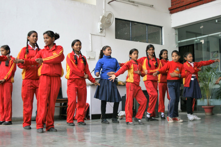 Students enrolled in Prerna Girls School practice for an upcoming concert in Lucknow, India.