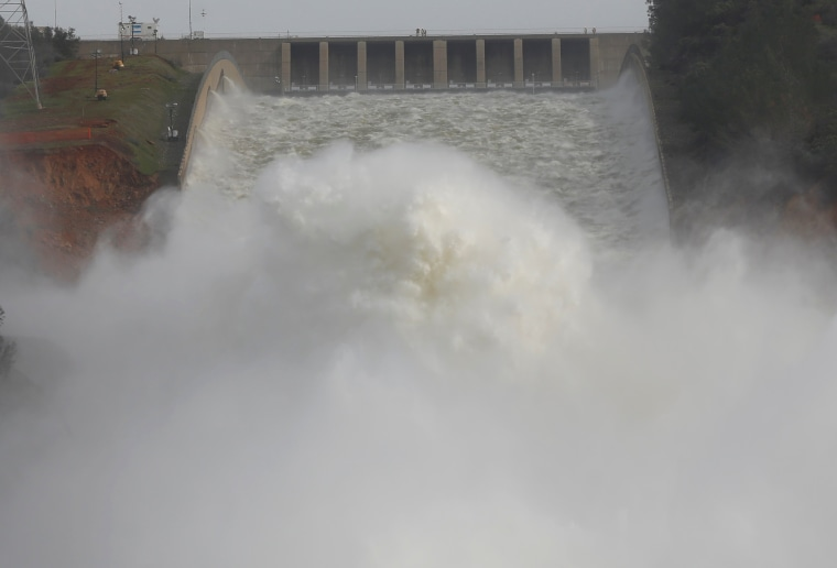 Image: Water is released from the Lake Oroville Dam after an evacuation was ordered for communities downstream from the dam in Oroville, California