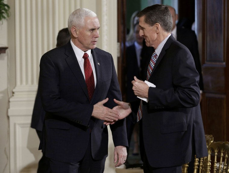 Image: U.S. Vice President Pence greets National Security Advisor Flynn before Abe-Trump news conference at the White House in Washington.
