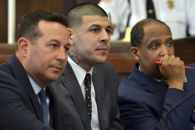 Image: Aaron Hernandez and his attorneys at his double murder trial in Boston