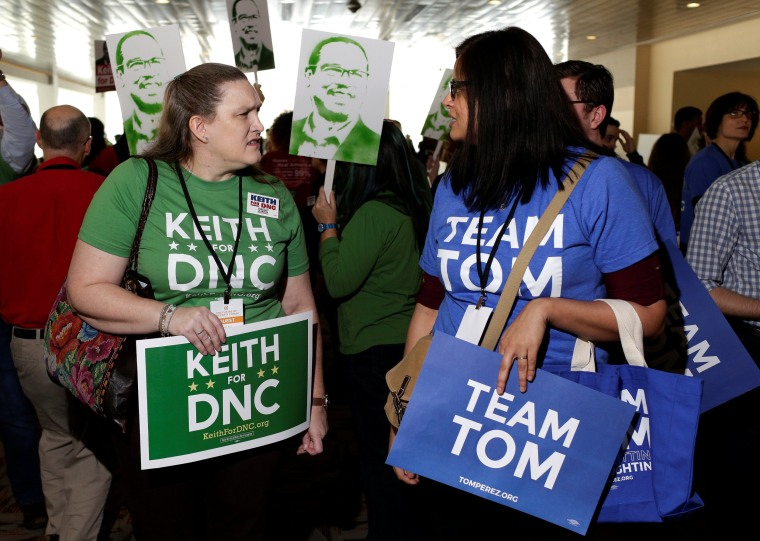 Image: Supporters of Rep. Keith Ellison and former Secretary of Labor Tom Perez, candidates for Democratic National Committee Chairman, speak to each other during a Democratic National Committee forum in Baltimore, Maryland