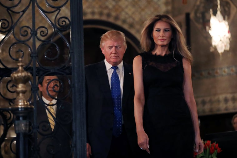 Image: U.S. President Donald Trump, First Lady Melania Trump and Japanese Prime Minister Shinzo Abe (L) walk to pose for a photograph before attending dinner at Mar-a-Lago Club in Palm Beach, Florida, U.S.