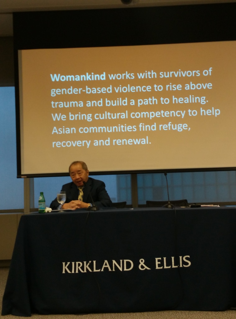 Womankind executive director Larry Lee at a press conference announcing the organization's re-branding.