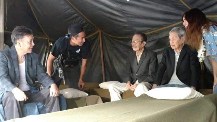 "On the set of ""Go For Broke"" with actors Ban Daisuke (L) (portraying Matsujiro Otani) with Bishop Yoshiaki ""Sharkey"" Fujitani (age 93) and Ted Tsukiyama (age 96), real veterans portraying Japanese-American prisoners in the film."