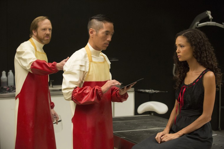 "Image: Leonardo Nam (C) is pictured with fellow actors Ptolemy Slocum and Thandie Newton during an episode of HBO's ""Westworld."""