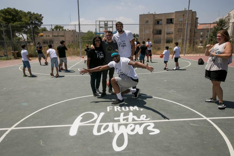 L to R: Executive Director of the NBPA Foundation Sherrie Deans, Matteo Zuretti, Director of International Relations, Rudy Gay, Omri Casspi.