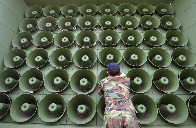 Image: A South Korean soldier takes down a battery of propaganda loudspeakers on the border with in Paju, North Korea