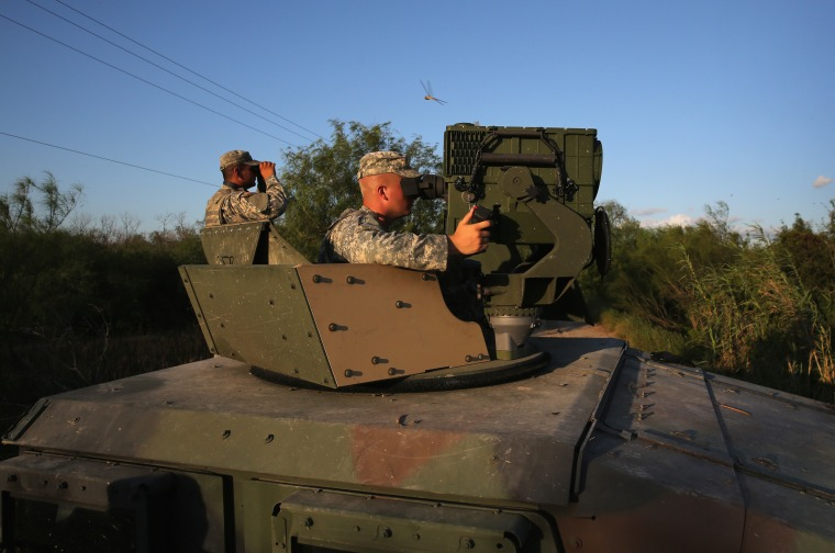 Image: Texas National Guard soldiers monitor the U.S.-Mexico in 2014
